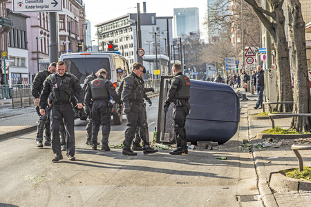 riots: FRANKFURT, GERMANY - MAR 18, 2015: people demonstrate against EZB and Capitalism in Frankfurt, Germany. Some people destroy windows and objects at the street are burning.