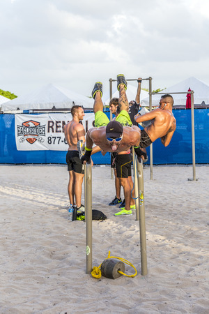 south beach: MIAMI, USA - AUG 30, 2014: bodybuilder train at  south beach in Miami, USA. The free fitness area is famous for posing athletic bodies and am afternoon meeting point.