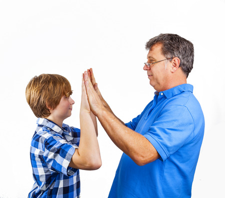 happy father and son giving weight to hands photo