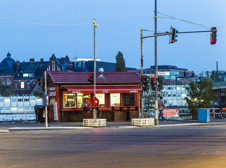 speciality: BERLIN, GERMANY - NOV 27, 2014 : a curry sausage kiosk sells the berlin food speciality in the evening in Berlin, Germany. Currywurst is the most famous Berlin fast food. Editorial