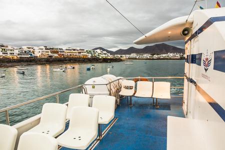 playa blanca: PLAYA BLANCA, SPAIN - NOV 19, 2014: the Videocosta ferries operate between Corallejo and Playa Blanca, Spain. The ticket for local people is reduced.