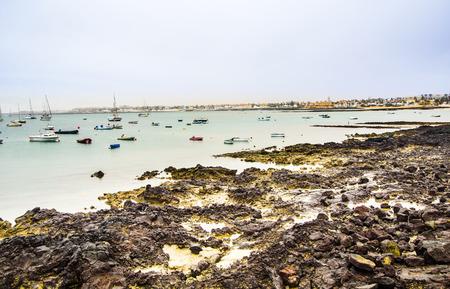 corralejo: view to scenic  harbor village Corralejo in Fuerteventura with boats