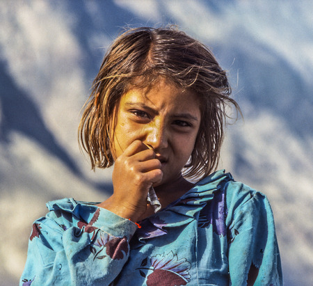 GILGIT, PAKISTAN - JUL 1, 1987: portrait of unknown farmer woman in Gilgit, Pakistan. People suffer in that area because of the Afghanistan war.