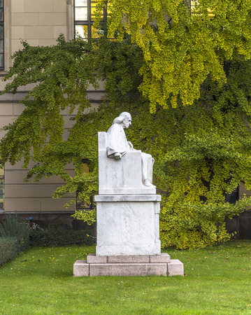 alma: BERLIN, GERMANY - OCT 27, 2014: statue and facade of Humboldt university in Berlin, Germany. In 1810 Wilhelm von Humboldt founded the new type of university with the ideal of research and science. Editorial