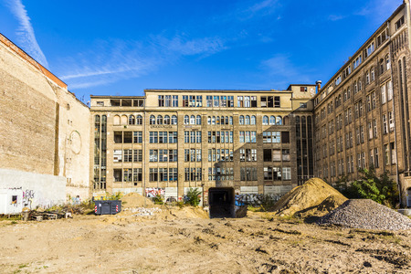 graffito: BERLIN, GERMANY - NOV 28, 2014: view to facade of a demlition house in Berlin, Germany. Due to ongoing clarification of ownership the rate of old houses in Berlin is still high.