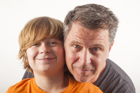 smooching: father and happy son hugging Stock Photo