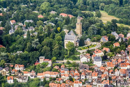 aerial view to Castle of Kronberg with old village and trees