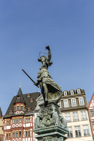 sword act: tatue of Lady Justice (Justitia) in Frankfurt, Germany