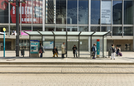 brandt: FRANKFURT, GERMANY- APR 8, 2015 : people wait at train station Willi Brandt Platz in Midday in Frankfurt, Germany. Willi Brandt Platz was inaugurated in 1993 and honors the former german prime minister. Editorial