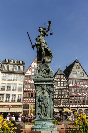 sword act: FRANKFURT, GERMANY- APR 8, 2015:Justitia Statue at the Romer square, one of the oldest and most historic sections of Frankfurt am Main, Germany, Europe.