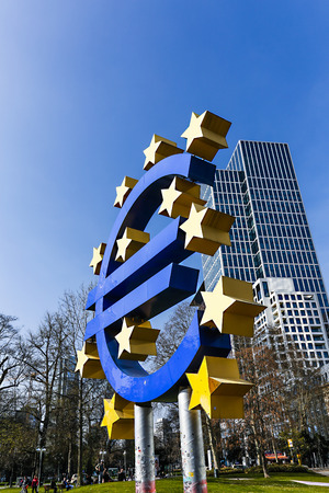 FRANKFURT, GERMANY - APRIL 8, 2015: The Euro sign looking a little worn outside the European Central Bank headquarters in Frankfurt, Germany symbolizing a financial crisis. Editorial