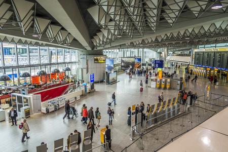 handled: FRANKFURT, GERMANY - MAR 28, 2015: people at the Airport in daytime in Frankfurt, Germany. In 2012, Frankfurt handled 57.5 million passengers. Editorial