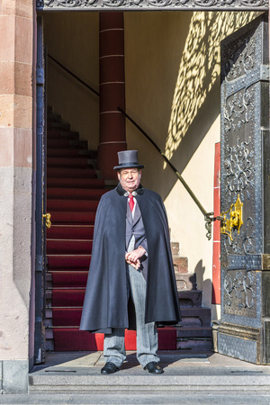 18th: FRANKFURT, GERMANY - MAR 6, 2015: guard at entrance of the town hall in Frankfurt, Germany. He wears traditional clothes from the 18th century.