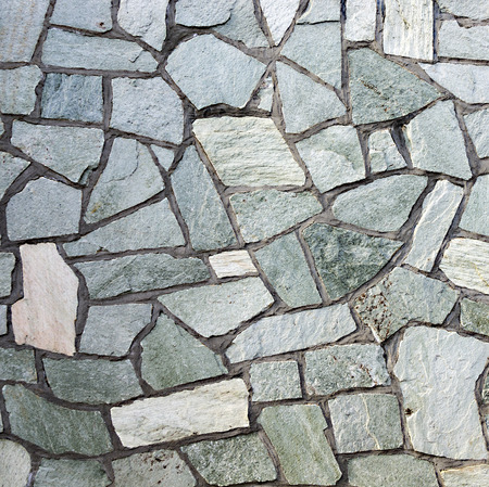 varying: section of flagstone wall with varying shapes and lines