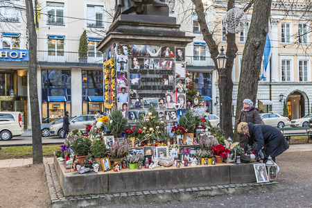 MUNICH, GERMANY - DEC 27, 2013 : people remember Michael Jackson with cards and letters at the statue of Orlando di Lasso  in Munich, Germany. Jackson died on June 25,2009 in Los Angeles.