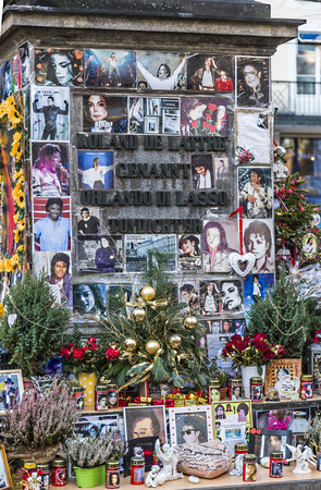 michael jackson: MUNICH, GERMANY - DEC 27, 2013 : people remember Michael Jackson with cards and letters at the statue of Orlando di Lasso  in Munich, Germany. Jackson died on June 25,2009 in Los Angeles.