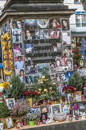 pop idol: MUNICH, GERMANY - DEC 27, 2013 : people remember Michael Jackson with cards and letters at the statue of Orlando di Lasso  in Munich, Germany. Jackson died on June 25,2009 in Los Angeles.