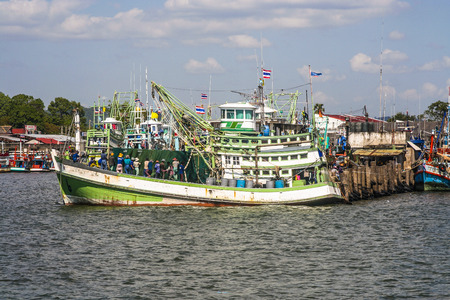 lonelyness: wooden local fisherboat in the harbor of Rayong, Thailand. Fishing is an important industry in Thailand.