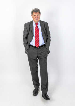 smiling mature businessman with tie and suit photo