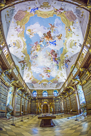 volumes: MELK, AUSTRIA - APRIL 23, 2015: The luxurious interior of the Library in Melk Abbeyin Melk, Austria. Famous Melk Abbey Library has over 100,000 Volumes in Collection.