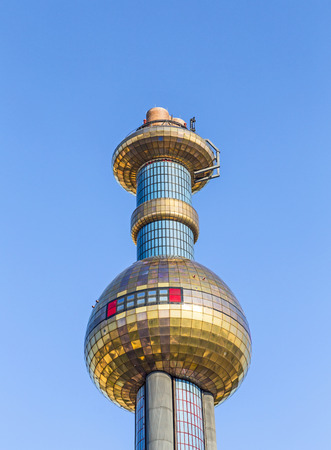 heats: VIENNA, AUSTRIA - APRIL 2015: Tower of Garbage-processing plant in Vienna, Austria. Designed by Friedensreich Hundertwasser. It was inaugurated in 1992 and heats 60000 apartments