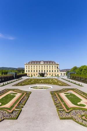 schloss schonbrunn: VIENNA, AUSTRIA - APRIL 24, 2015: Schonbrunn Palace with prince garden view in Vienna, Austria.  The former imperial summer residence is  Viennas most visited tourist attraction.