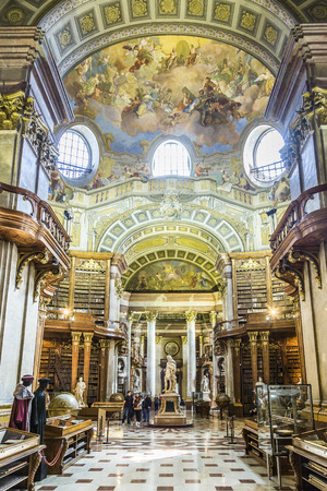 est: VIENNA, AUSTRIA - APR 24, 2015:  books in the beautiful Austrian National Library in Vienna, Austria. Est in 18th century, the largest library in Austria with 7.4 mill items. Editorial