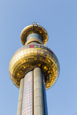 VIENNA, AUSTRIA - APRIL 2015: Tower of Garbage-processing plant in Vienna, Austria. Designed by Friedensreich Hundertwasser. It was inaugurated in 1992 and heats 60000 apartments