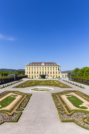 schonbrunn palace: VIENNA, AUSTRIA - APRIL 24, 2015: Schonbrunn Palace with prince garden view in Vienna, Austria.  The former imperial summer residence is  Viennas most visited tourist attraction.