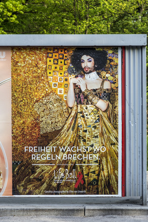 wurst: VIENNA, AUSTRIA - APR 27, 2015:  poster at a bus stop for the european song contest in Vienna, Austria. Conchita Wurst was the winner in the last year and the next contest always takes place in the winners country.