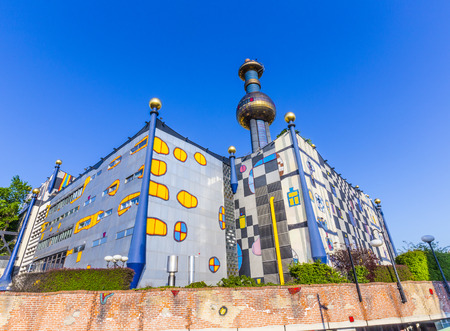 VIENNA, AUSTRIA - APR 24, 2015: The District heating plant in Vienna, Austria.  Designed by the famous Austrian artist and architect Friedensreich Hundertwasser. It was inaugurated in 1992.