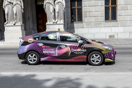 wurst: VIENNA, AUSTRIA - APR 27, 2015:  taxi with advertising for the european song contest in Vienna, Austria. Conchita Wurst was the winner in the last year.