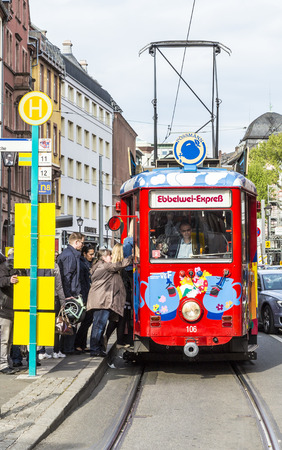 FRANKFURT, GERMANY - MAY 2, 2015: people enjoy the ride with the Ebbelwei express in Frankfurt, Germany, The Ebbelwei-Express is a touristic line established in 1977.