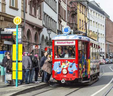 ist: FRANKFURT, GERMANY - MAY 2, 2015: people enjoy the ride with the Ebbelwei express in Frankfurt, Germany, The Ebbelwei-Expreß ist a touristic line established in 1977.