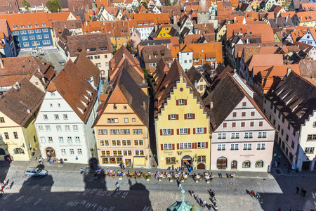 der: ROTHENBURG, GERMANY - APR 19, 2015: aerial of the market place of Rothenburg ob der Tauber, Germany. The medieval town attracts over 2 million visitors every year. Editorial