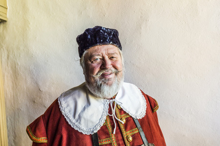 guid: ROTHENBURG, GERMANY: old man dressed in medieval clothes in Rothenburg, Germany. Especially the japanese tourists enjoy tours guided by people in historic costumes. Editorial