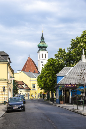 19: VIENNA, AUSTRIA - APR 27, 2015: Grinzing With Church And Himmelstrasse In district No 19 in Vienna, Austria. Grinzing is famous for its vineyards and wine.