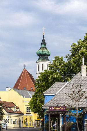 19: VIENNA AUSTRIA April 27 2015: Grinzing With Church And Himmelstrasse In District No 19 in Vienna Austria. Grinzing is famous for its vineyards and wine.