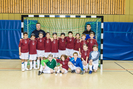 tricot: SCHWALBACH, GERMANY -FEB 2, 2008: Team E-youth of BSC soccer club proudly poses for photo in Schwalbach, Germany. Training of childs is important for future sport success.