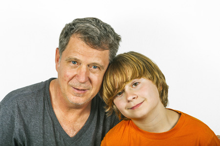 smooching: father and son hugging in studio isolated on white