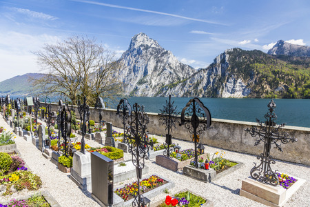 johannes: TRAUNKIRCHEN, AUSTRIA - APR 22, 2015: old cemetery at the church yard in Traunkichen, Austria. The abbey was already in existance by 632 A.D.