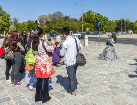 schloss schoenbrunn: VIENNA, AUSTRIA - APRIL 24, 2015: people take pictures of actors in Vienna, Austria.  The former imperial summer residence is a UNESCO World Heritage site and Viennas most-visited tourist attraction.