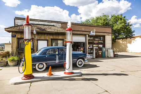 old timer: WILLIAMS, USA - JUL 8, 2008:  old retro filling station in Williams, USA. In 1926,Highway 66 was established and  today, all of downtown Williams is on the National Register of Historic Places.