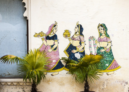 famous paintings: UDAIPUR, INDIA - OCT 21, 2012: famous wall paintings shows women carrying parfumes,water and  necklaces in ancient times   in Udaipur, India. Editorial
