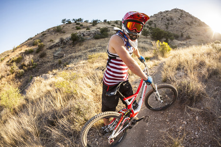tuscon: TUSCON, USA - DEC 4, 2011: downhill rider Simon Seeholzer at training on the trail in Tuscon, USA. There are yearly around 1000 bicycle related deaths in the US, 75 % due to head injuries.