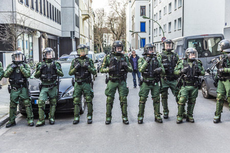 riots: FRANKFURT, GERMANY - MAR 18, 2015: police pays attention at demonstration against EZB and Capitalism in Frankfurt, Germany. 30 tsd. people join the demo. Editorial