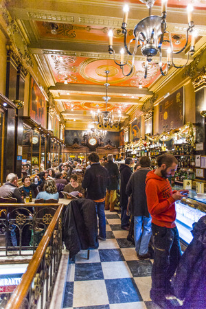 old quarter: LISBON, PORTUGAL - DEC 27, 2008: people enjoy the Cafe A Brasileira in Lisbon, Portugal. The Cafe  is one of the oldest and most famous cafes in the old quarter of Lisbon. Editorial