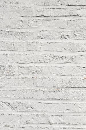 harmonic: white harmonic brick wall of an ancient house