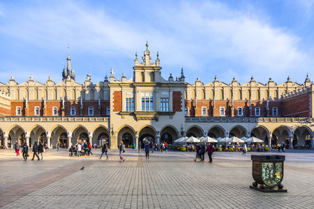 KRAKOW, POLAND - DEC 12, 2014: view of main market square from Cloth Hall building. Krakow is most often visited city in Poland by foreign tourists.