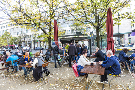 BERLIN, GERMANY - OCT 27, 2014: old vintage Kiosk name is renamed to oval office and people enjoy on tables the autumn summer in Berlin, Germany.